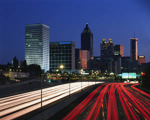 Getty Images PhotoDisc V16: US Landmarks and Travel Horizontal, Photography, Color Image, Nobody, Long Exposure, Traffic, Outdoors, Atlanta, Tail Light, Night, Building Structure, Skyline, Urban Scene, Headlight, Multiple Lane Highway, Travel Destinations, City Location